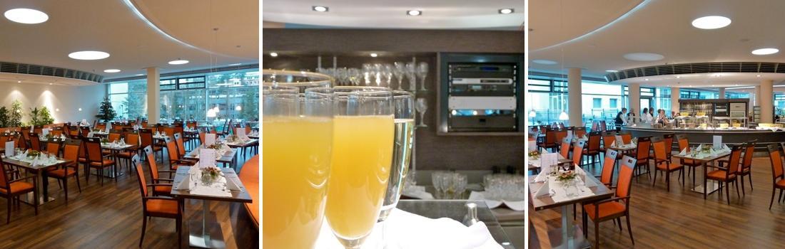 Das Bild zeigt eine Collage zum Projekt Speisesaal Rathsberg Erlangen. Das linke und rechte Bild zeigen den modernen Speisesaal, jeweils eine Spiegelseite. Das mittlere Bild zeigt gefüllte Gläser auf einem Tablett, mit Orange-Sekt und Sekt gefüllt. Im Hintergrund ist die kompakte ELA-Zentrale zu sehen.